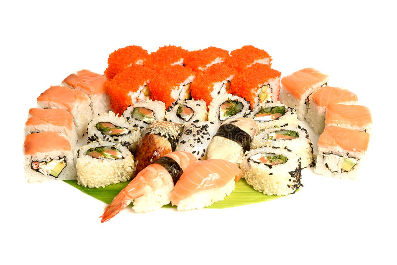 Japanese food restaurant delivery - sushi maki california gunkan roll platter big set isolated at white background. Above view royalty free stock photo