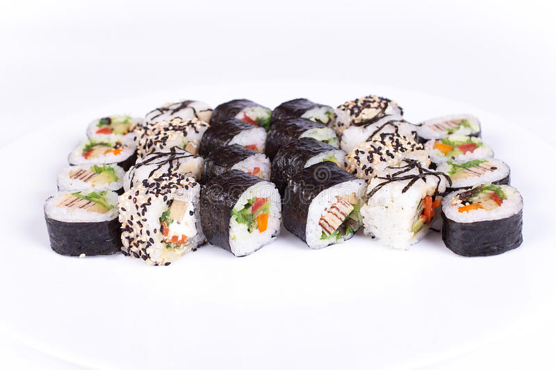 Japanese food restaurant, sushi maki gunkan roll plate or platter set. California rolls with salmon. isolated at white. Japanese food restaurant, sushi maki royalty free stock images