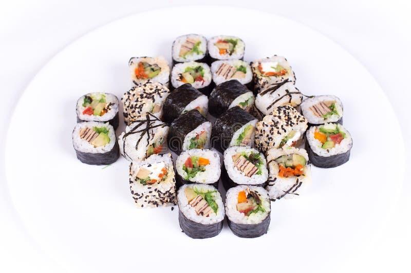 Japanese food restaurant, sushi maki gunkan roll plate or platter set. California rolls with salmon. isolated at white. Japanese food restaurant, sushi maki stock image