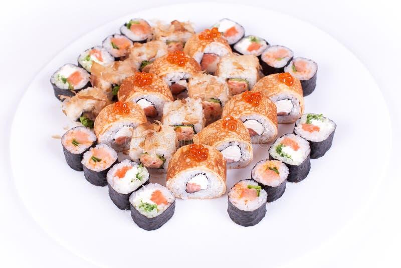 Japanese food restaurant, sushi maki gunkan roll plate or platter set. California rolls with salmon. isolated at white. Japanese food restaurant, sushi maki royalty free stock image