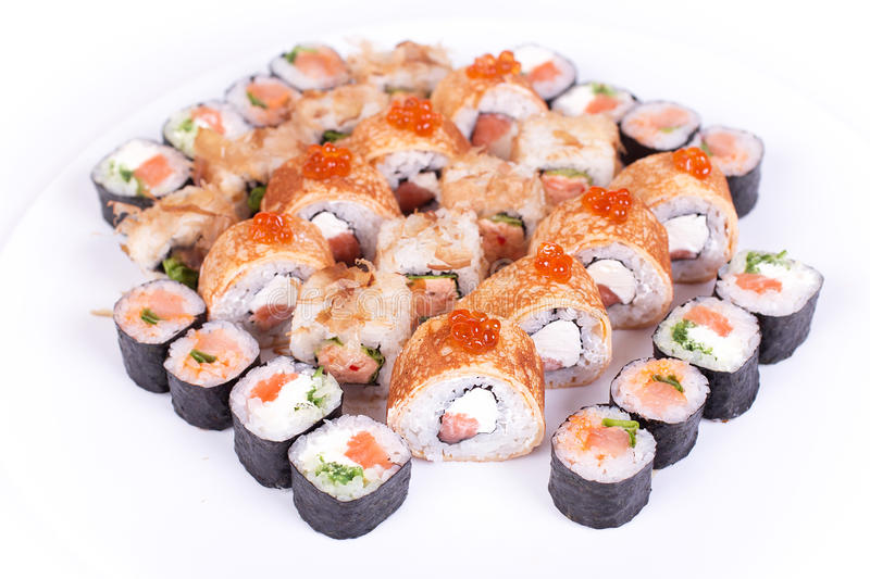 Japanese food restaurant, sushi maki gunkan roll plate or platter set. California rolls with salmon. isolated at white backgroun. Japanese food restaurant, sushi royalty free stock images
