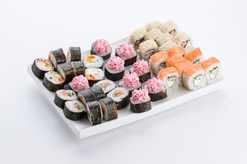 Japanese food restaurant, sushi maki gunkan roll plate or platter set. Sushi set and composition. Sushi set and composition at white background. Japanese food royalty free stock photo