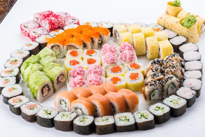 Japanese food restaurant, sushi maki gunkan roll plate or platter set. Sushi set and composition. Sushi set and composition at white background. Japanese food royalty free stock photos