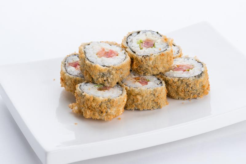 Japanese food restaurant, sushi maki gunkan roll plate or platter set. Sushi set and composition. Sushi set and composition at white background. Japanese food stock photography