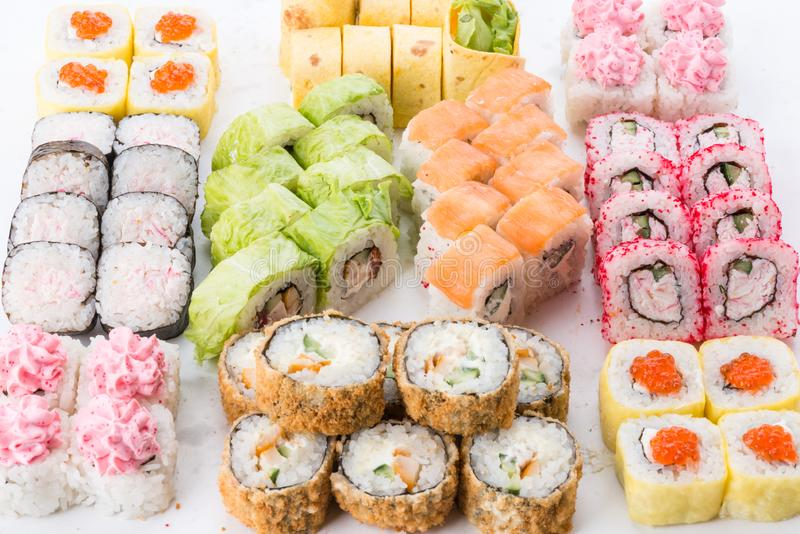 Japanese food restaurant, sushi maki gunkan roll plate or platter set. Sushi set and composition. Sushi set and composition at white background. Japanese food stock image