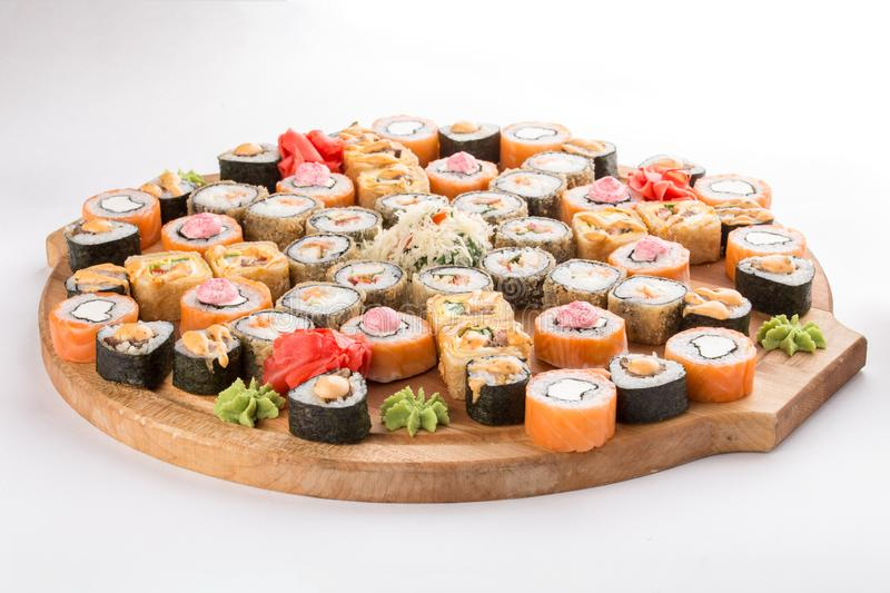Japanese food restaurant sushi maki roll plate or platter set isolated on white background. Side view royalty free stock photography