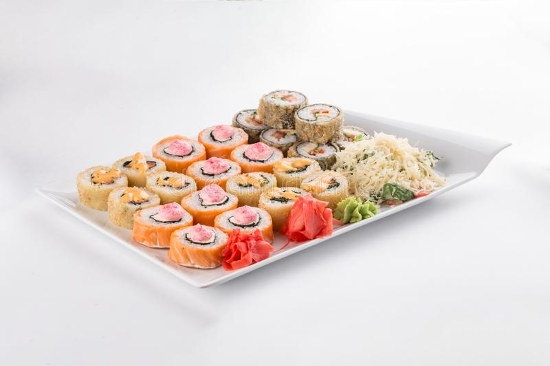 Japanese food restaurant sushi maki roll plate or platter set isolated on white background. Side view royalty free stock images
