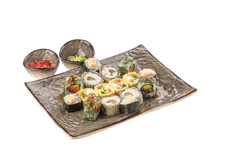 Japanese food restaurant sushi maki roll plate or platter set isolated on white background. Side view stock image