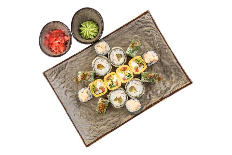 Japanese food restaurant sushi maki roll plate or platter set isolated on white background. Top view royalty free stock photo