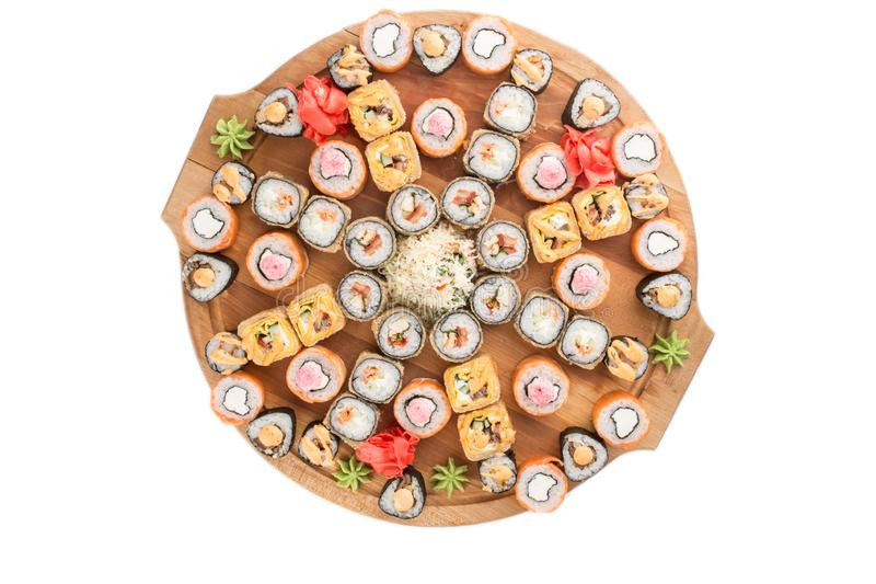 Japanese food restaurant sushi maki roll plate or platter set isolated on white background. Top view stock photography