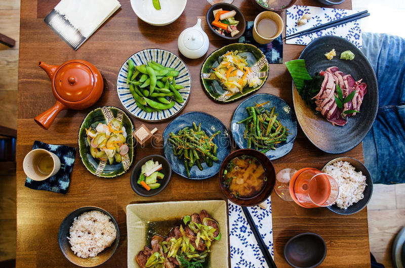 Japanese food at the restaurant. Restaurant table with japanese food stock photos