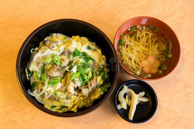 Japanese food, rice with pork, soup and pickle stock images