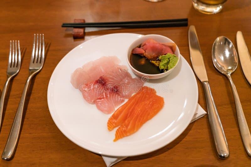 Japanese food with Salmon Sashimi and sinappi. Delicious Japanese food with Salmon Sashimi and sinappi royalty free stock photography