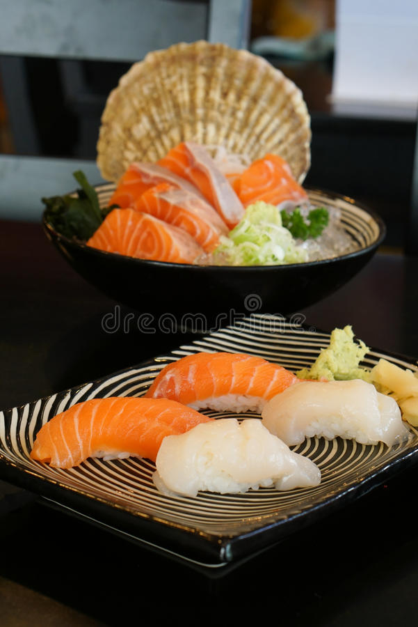 Japanese food - Salmon Sushi and shell sushi royalty free stock image