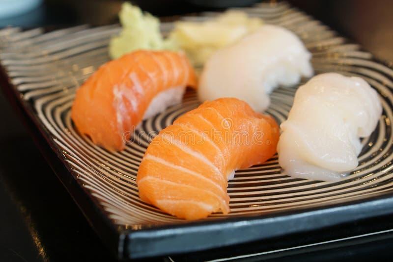Japanese food - Salmon Sushi and shell sushi stock photo