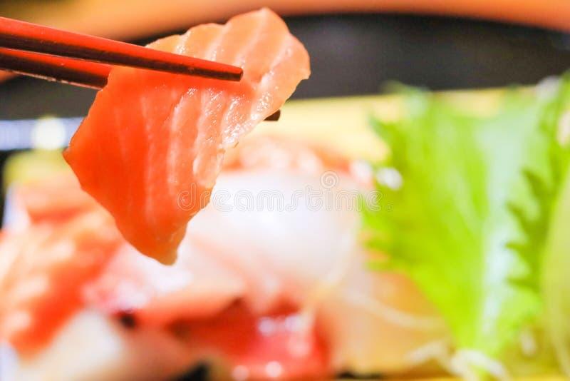 Japanese food,sashimi with chopsticks. Japanese food, sashimi with chopsticks stock image