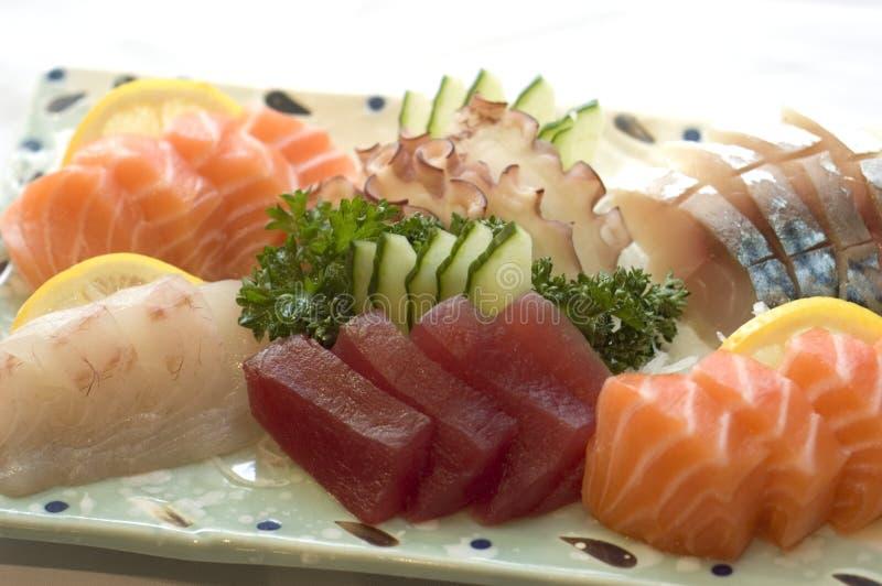Japanese Food,Sashimi, Menu. Japanese Food, Plate of Sashimi, Sliced Raw Fish, Tuna, Salmon, Mackeral,,PS-43056 royalty free stock photography
