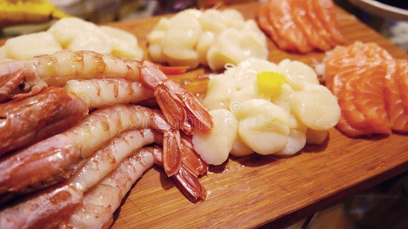 Japanese food sashimi set on wooden tray. Japanese food sashimi set on the wooden tray royalty free stock photography