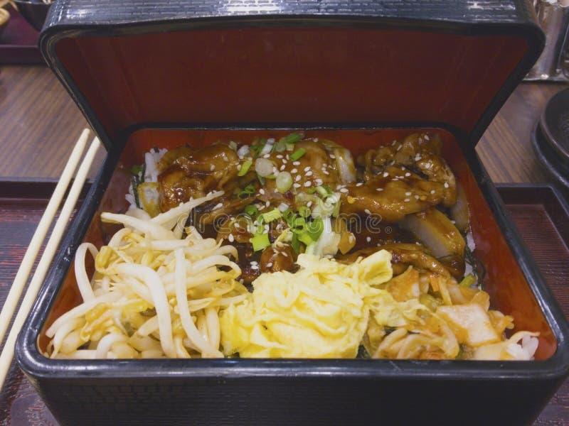 Japanese food set, stir-fried pork with soy sauce, sprinkled wit royalty free stock photo