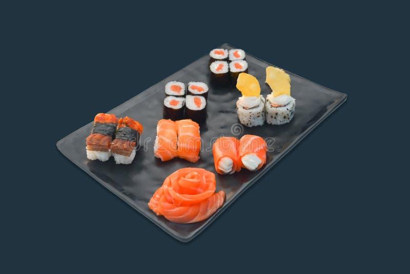 Japanese food set Sushi roll, sashimi, nigiri. Japanese food set Sushi roll, sashimi blossom, nigiri on black background stock image
