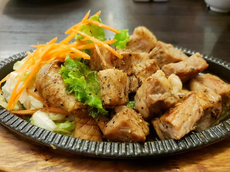 Japanese food style, Top view of buta steak with fried carrot, lettuce, cabbage on the table. Japanese food style, Top view of buta steak with fried carrot stock photos