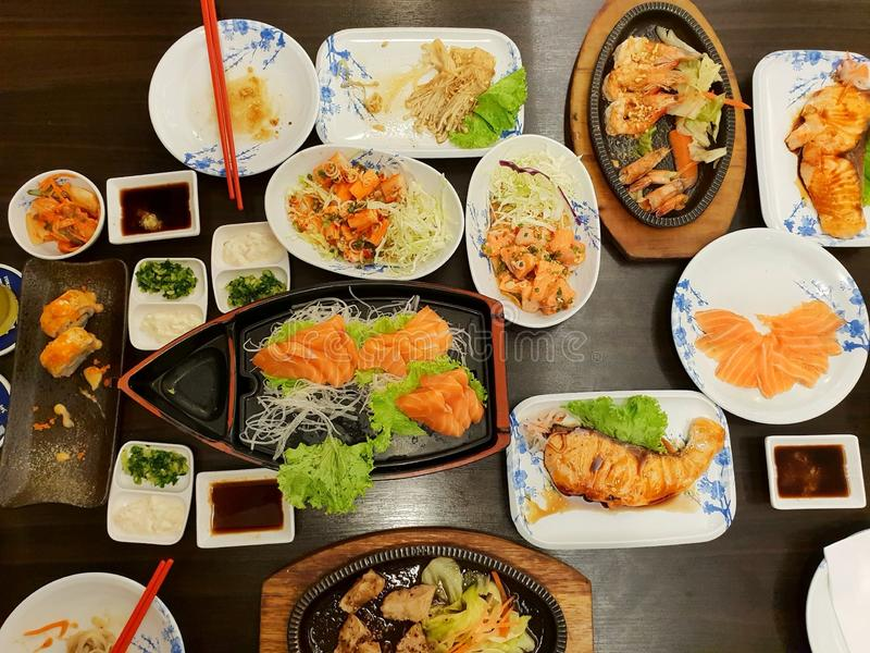 Japanese food style, Top view of shrimp steak, buta steak, sushi, shrimp salad, teriyaki sauce, salmon slice and rice. On the table, japan food set in royalty free stock photos