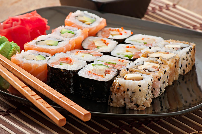 Japanese food - Sushi and Sashimi. On plate stock photography