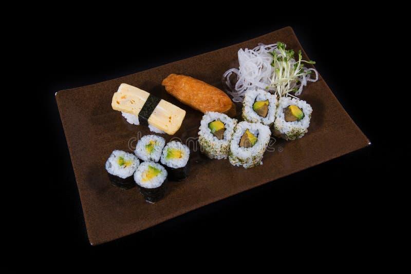 Japanese food. Japanese sushi, seafood, salmon fresh squid, salmon vegetalbe green fresh, shirmp, sashimi, fried, udon octopus rice, cake, mochi royalty free stock images