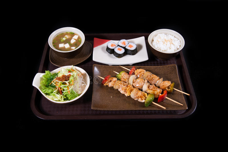 Japanese food. Japanese sushi, seafood, salmon fresh squid, salmon vegetalbe green fresh, shirmp, sashimi, fried, udon octopus rice, cake, mochi royalty free stock photo