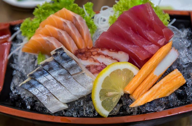 Japanese foods sashimi raw sliced fish, Japan of raw fresh fish fillet sashimi  , Assorted Japanese sashimi. royalty free stock photos