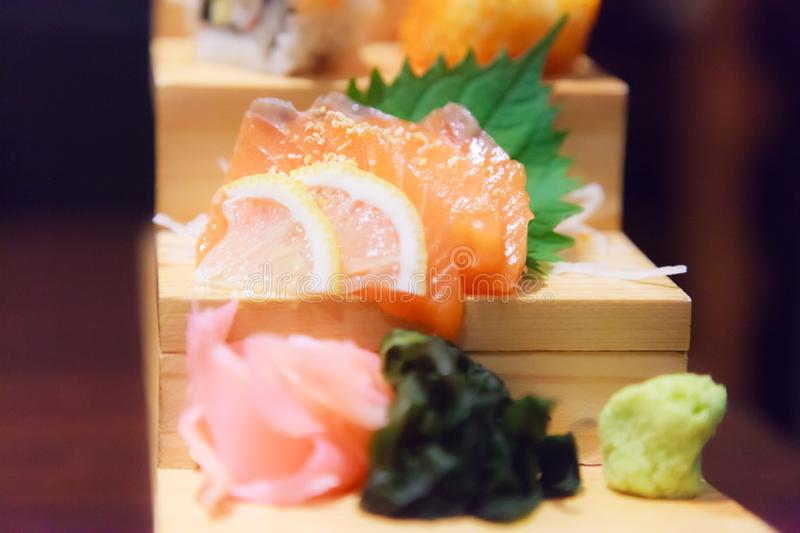 Japanese Fresh Fish Food Dish Menu, Salmon Sashimi, seaweed, ginger and wasabi decorated on wooden step in traditional Japanese. Restaurant. Healthy Food rich royalty free stock photos