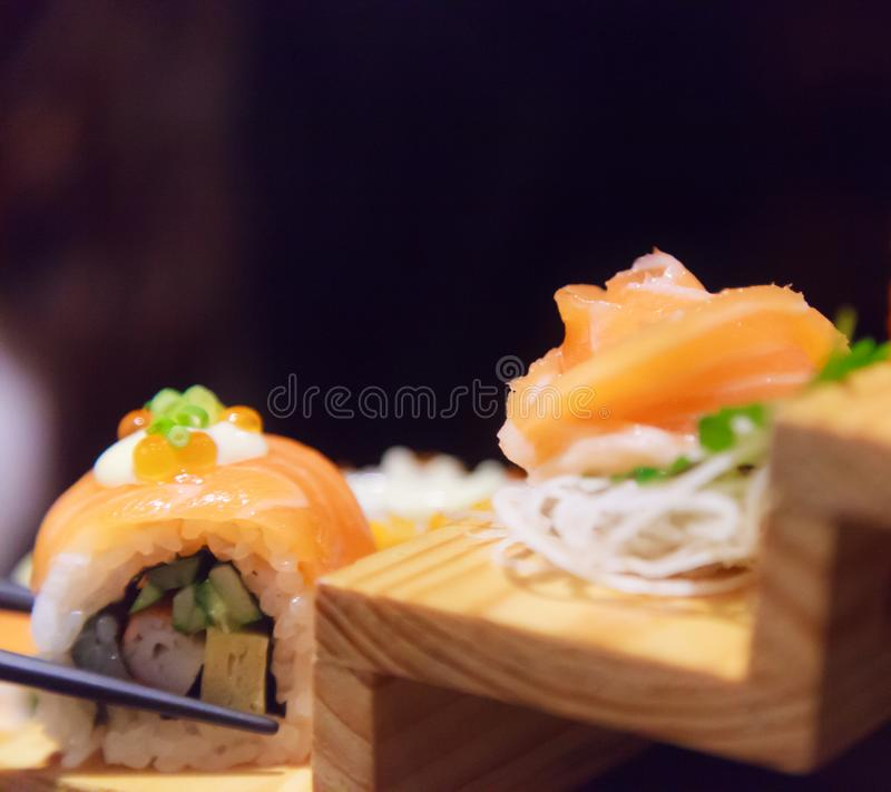 Japanese Fresh Fish Food Dish Menu, Salmon Sushi and Sashimi Assortment decorating on wooden steps in traditional Japanese. Restaurant. Healthy Food rich with royalty free stock photography