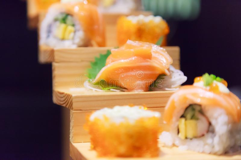 Japanese Fresh Fish Food Dish Menu, Salmon Sushi and Sashimi Assortment decorating on wooden steps in traditional Japanese. Restaurant. Healthy Food rich with stock images
