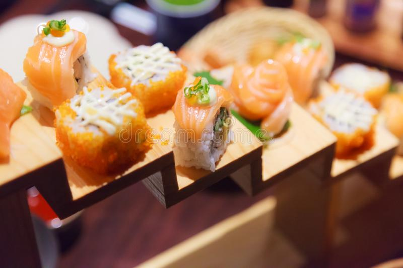 Japanese Fresh Fish Food Dish Menu, Salmon Sushi and Sashimi Assortment decorating on wooden steps in traditional Japanese. Restaurant. Healthy Food rich with stock photography