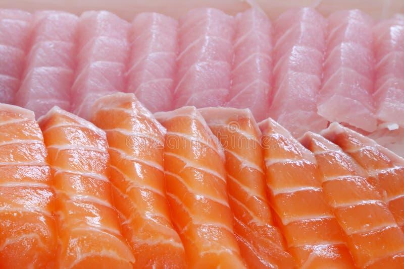 Japanese fresh sashimi (salmon and fatty tuna). The close up of Japanese fresh sashimi (salmon and fatty tuna) in white lunch box set royalty free stock photography