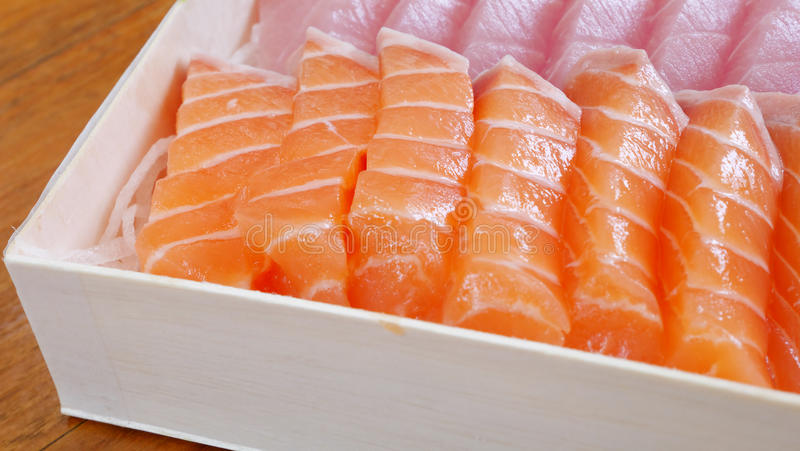 Japanese fresh sashimi (salmon and fatty tuna). The close up of Japanese fresh sashimi (salmon and fatty tuna) in white lunch box set stock images