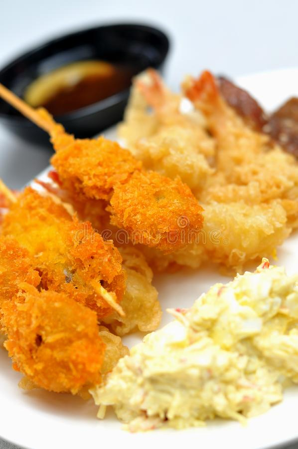 Japanese fried food and egg salad stock images