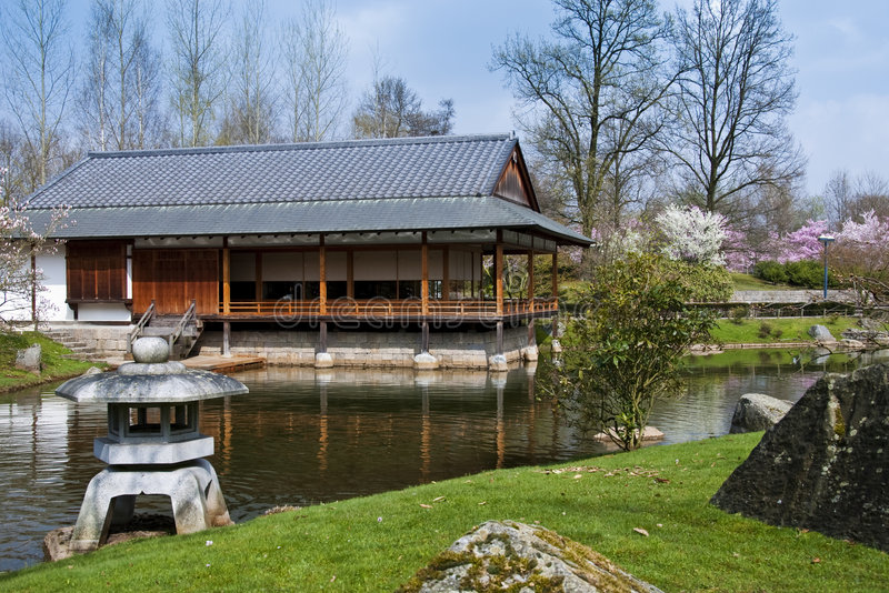 Japanese Garden, Hasselt, Belgium. A tea house sits by a tranquil pond in the Japanese Garden in Hasselt, Belgium stock image