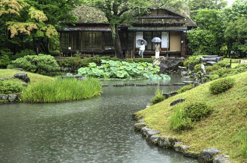 Japanese garden Isuien in Nara. Japanese landscape garden with pond Isuien in Nara during rainy weather stock image