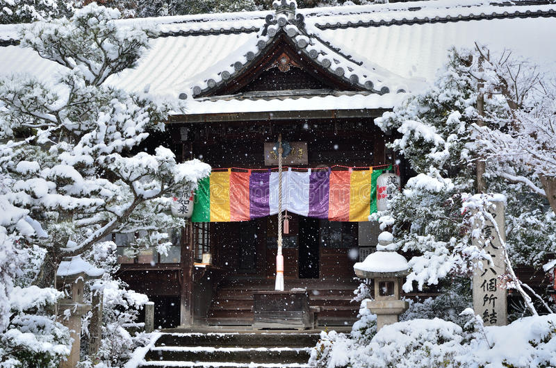 Snow falling on Japanese garden in Kyoto. royalty free stock images
