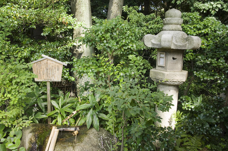 Japanese garden, Nagoya, Japan. Traditional stone lantern in Japanese garden Tokugawaen in Nagoya, Japan royalty free stock photography