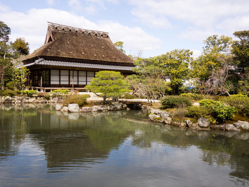 Japanese garden with pond and tea house stock photo