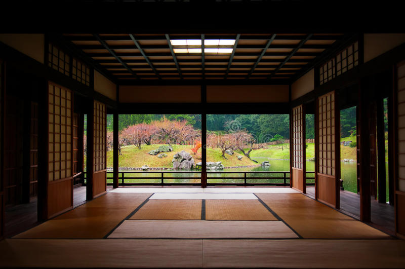 Japanese garden seen through tatami room. stock images