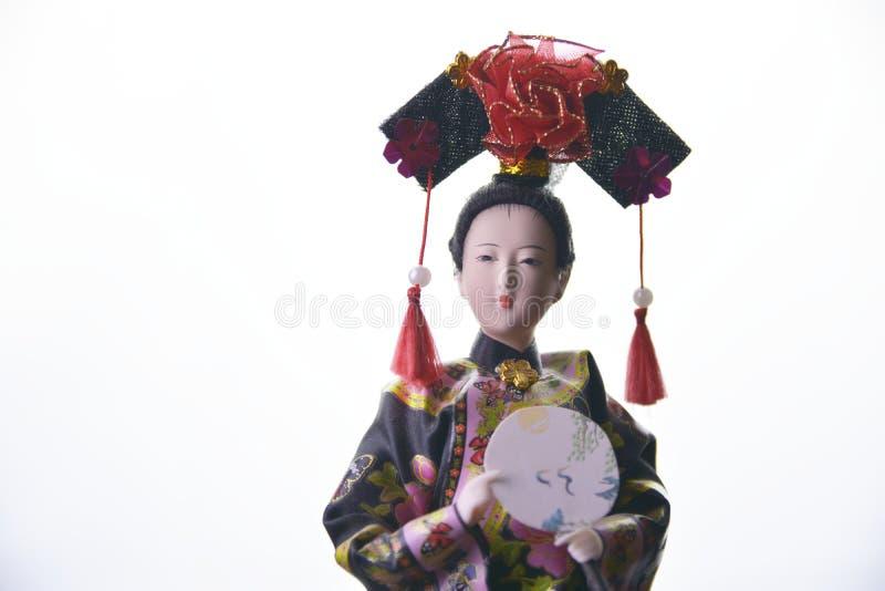 Japanese geisha doll on white background close-up royalty free stock image