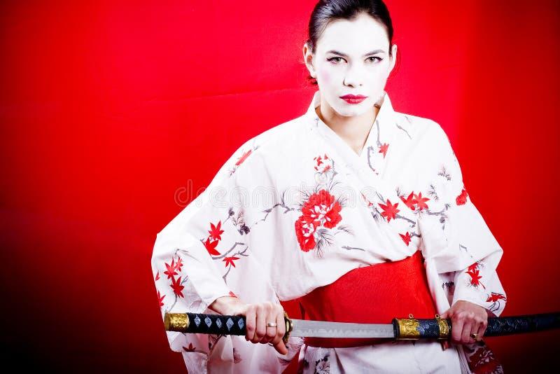 Japanese geisha with sword stock image