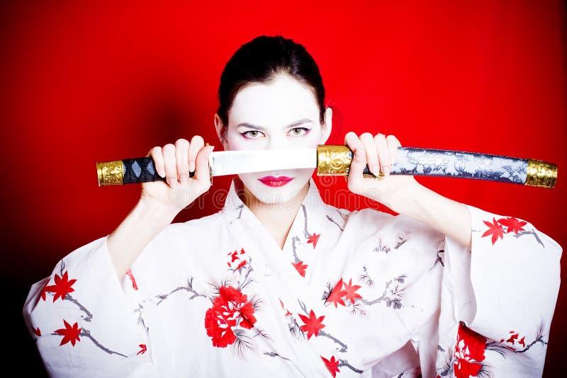 Japanese Geisha with sword stock photo