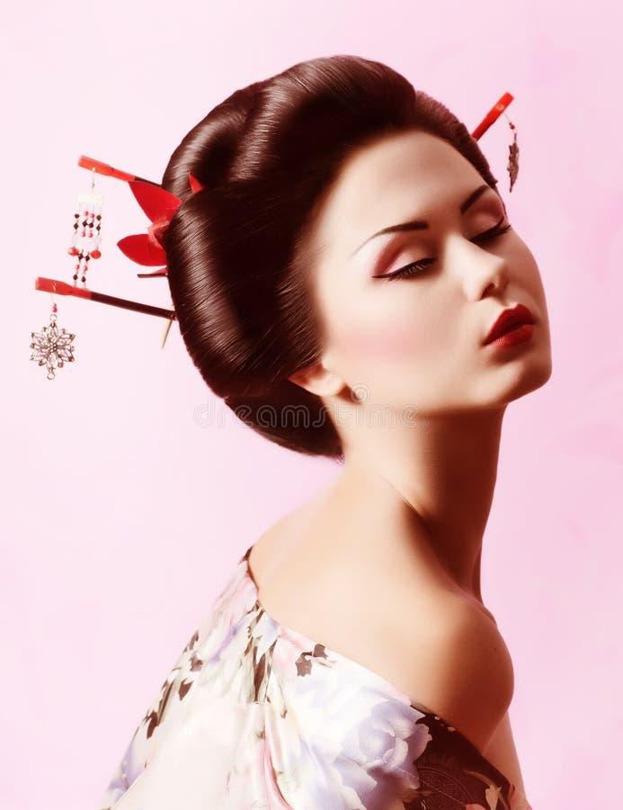 Japanese geisha woman. Portrait of a Japanese geisha woman royalty free stock photos