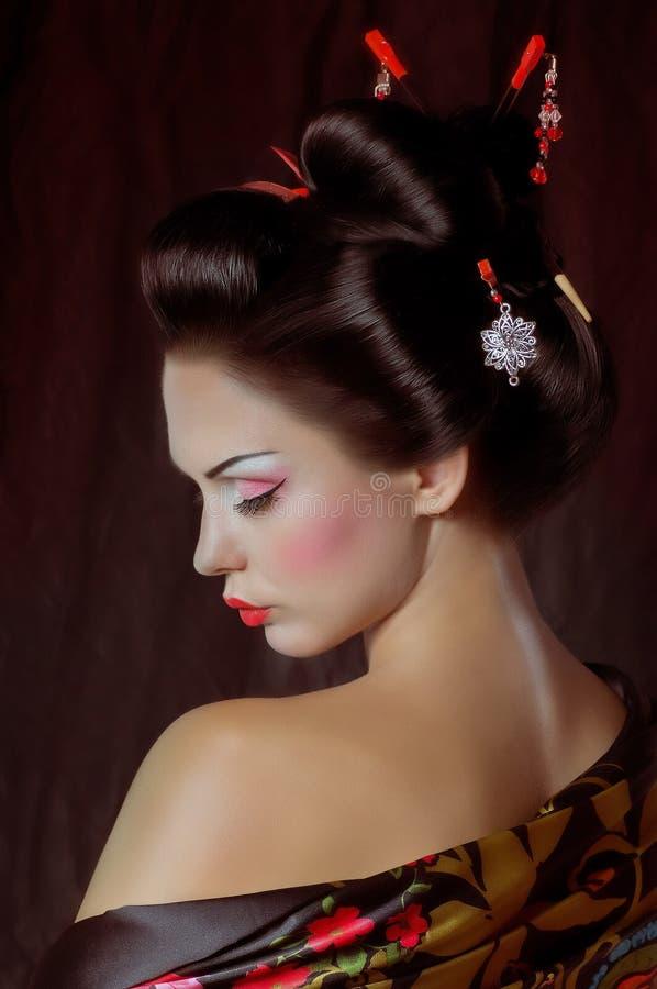 Japanese geisha woman. Portrait of a Japanese geisha woman royalty free stock photography