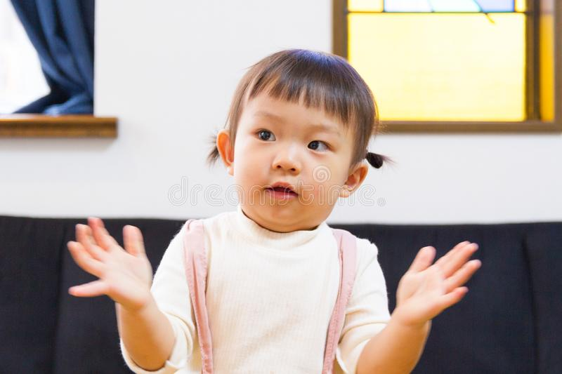 1-year-old girl dancing with expressive hand movements. Japanese girl beating her hands to a song stock images