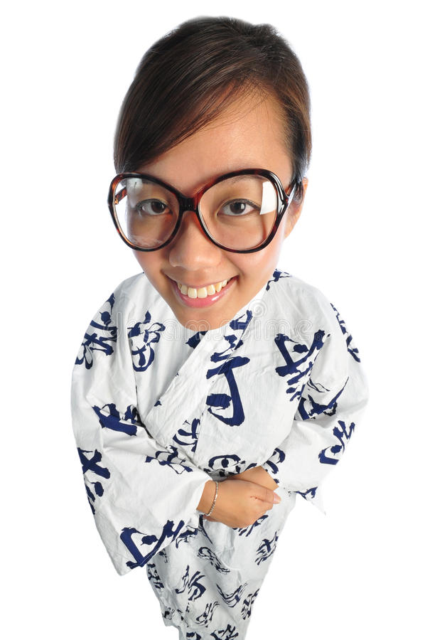 Japanese girl with big doll head. Beautiful young Asian Woman picture taken from the top to give a big doll head effect royalty free stock image